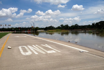 PHOTOS: Flooding closes FM 2499 in Flower Mound