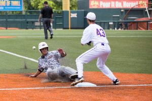 Tanner Boyzuick slides into the third in Argyle's win over Abilene Wylie last June. The Eagles are looking to defend their state championship this season. (Photo by Caleb Miles)