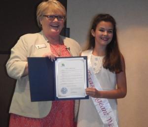 Highland Village Mayor Charlotte Wilcox honors baton twirling champion Chailie Alsaffar (Photo Courtesy: Amy Alsaffar).