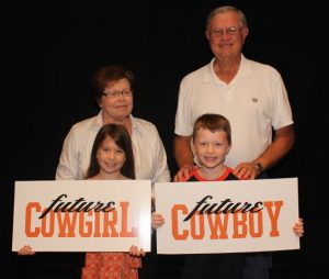 Connie and Jim Stiegler with two of their grand kids from Flower Mound (Photo Courtesy: OSU).