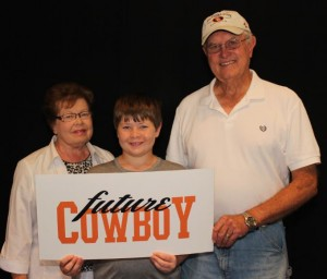 Connie and Jim Stiegler with one of their grandsons from Flower Mound (Photo Courtesy: OSU).
