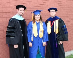 NCTC Honors Program student Jenna Stembridge (center) is pictured with NCTC Vice-President of Instructor Dr. Andrew Fisher (left) and NCTC President Dr. Brent Wallace before the Spring 2015 Graduation ceremony. Stembridge will attend Texas Tech University this fall (Photo Courtesy: NCTC)