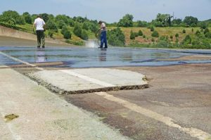 Workers clean up the Grapevine Lake spillway over Fairway Drive (Photo Courtesy: Town of Flower Mound).