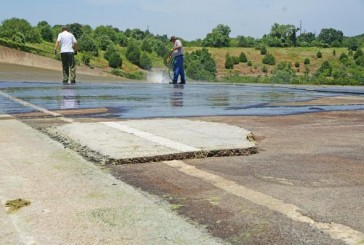 UPDATE: 'Dam Road' being cleaned, Grapevine Lake gates open