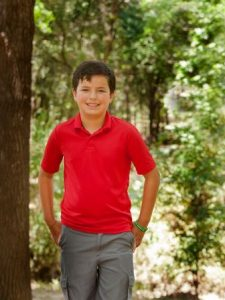 CJ McCue, 10, of Argyle has been dealing with the effects of West Nile Virus since he was first infected three years ago (Photo Credit: Helen's Photography).