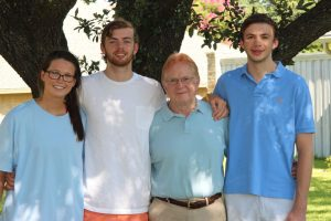 Bailey Beveridge, Joseph Clayton (second from left) and Matthew Clayton (right) worked to save Ron Clayton's life after he went into cardiac arrest while moving from Argyle to Dallas.