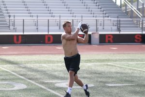 Jake Nelson catches a pass during Marcus football summer workouts on July 29.