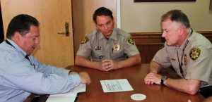 Sheriff Will Travis and chief deputy Rex George accept DEA funds for drug investigation (Photo Courtesy: DCSO).