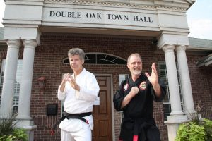 Double Oak residents Phil Miller and Gary Jordan offer free self-defense lessons each week at Double Oak Town Hall.