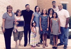 Mikaela Sedillo (sixth from left) with her family at Highland Village City Hall.