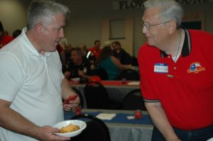 Flower Mound Fire Chief Eric Greaser chats with chaplain Mike Liles at a recent appreciation luncheon for first responders (Photo Courtesy: FMCC)