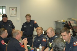 Firefighter and chaplain Jeff Burks (lower right) talks with fellow Flower Mound firefighters and police officers at a recent first responders appreciation luncheon (Photo Courtesy: FMCC)