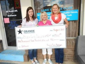 Lisa Tyler with Grande; J.B. (Babs) Troutman, BGCNCT president & chief professional officer; and Lori Salisbury (Photo Credit: Grande Communications).