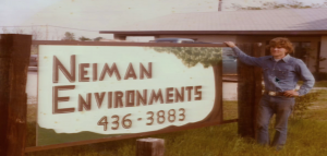 Bill Neiman stands by the sign at his former business in Flower Mound (Photo Courtesy: Bill Neiman).