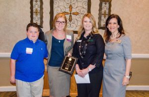 McAuliffe Elementary Principal  Jennifer Mattingly (second from left) accepted the award for the Flower Mound Chamber of Commerce's October School of the Month.