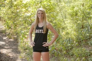 Madison Ralston excels in both cross country and basketball at Argyle High School. (Photo by Helen's Photography)