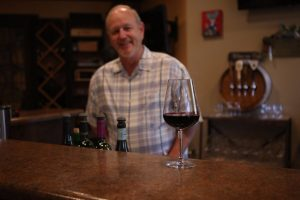 Dan Adams pours his heart into his business, Grapes to Wine in Bartonville Town Center near Lantana. (Photo by Foust Photography)