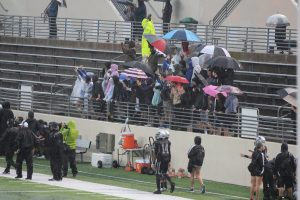 Fans brave the rain at Guyer's football game on Oct. 23.