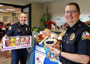 Flower Mound Police Chief Andy Kancel and Assistant Chief Wendell Mitchell collect toys for the Santa Cops program.