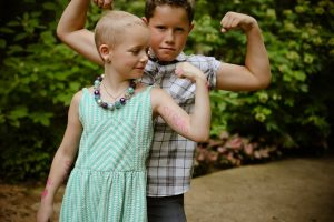 Sadie Keller of Lantana, pictured with her big brother, Grant, is being strong for herself and other children who are facing cancer. (Photo by Ashley Ford Photography)