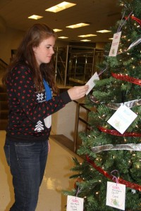 An Argyle High School student chooses an angel off of the tree. (Photo submitted by Pamela Arrington - Argyle ISD PR)