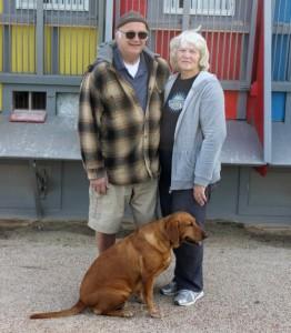 Bob and Karen Stubbs and their dog, Foxy, alongside the pigeon loft.