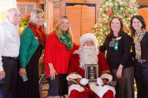 Donald Elementary Principal Michelle Wooten (third from left) accepted the award for the Flower Mound Chamber of Commerce's December School of the Month.