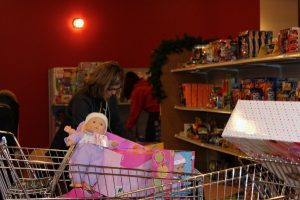 Help Wanted: It takes approximately 1,000 volunteers to help collect toys and work at CCA's Christmas Toy Store or shopping mall Giving Trees.