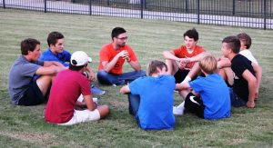 Boys gather with their leader to discuss real-life issues in their SOAK group.