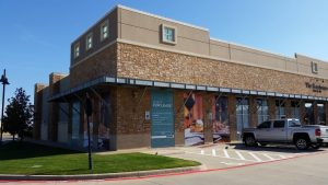 Torchy's Tacos will be located next to The Boardroom Salon for Men in The Shops at Highland Village.