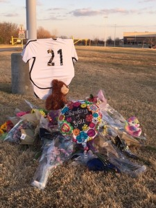 A makeshift memorial for Arely Naffarratte at Guyer High School.