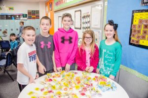 Heritage Elementary fifth graders sell candy grams and write letters to benefit Red Oak tornado victims.