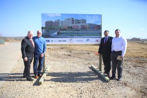 Pictured, left to right, with the rendering of Flower Mound's first hotel, The Courtyard by Marriott at the River Walk: New Era's Scott Tarwater, president and CEO, with Tim Lavender, founder and principal; Vice President and Project Manager Brad McCafferty of New Era; and, Jay Fuquay of Trinity Private Equity Group. (Photo by Foust Photography)