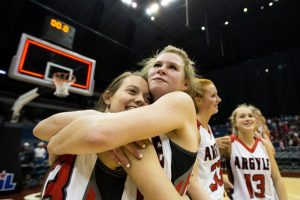 Seniors Olivia Gray and Kaylie King embrace their win over Liberty Hill 43-32 at the UIL State Basketball Semi-finals at Alamodome in San Antonio, TX on March 4, 2016. (Annabel Thorpe / The Talon News)