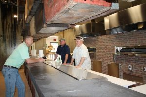 Earl's 377 Pizza co-owner Steve Watkins (left), manager Jason Ramey, and co-owner John 'Sparky' Pearson are getting ready to debut their new concept in Argyle next month.