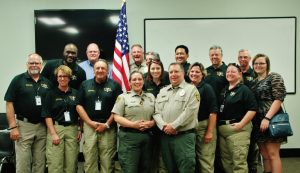 Volunteers in Police Services class members (front row, left to right): Bill Wood, Trish Wood, Tony Taliercio, Penny Campbell, Christina Wong, Charley Smith, Sandy Dutton and Cynthia Carmack. Back row, left to right): Brandon Harris, Rex Allen, Sheriff, Jill Mize, Steve Wong, Jerrold Mooney, George Campbell and Hannah Nestor.