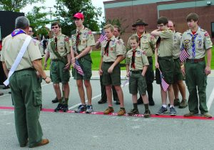 """Members of Boy Scout Troop 451 who helped with Flower Mound's inaugural Memorial Day event. Committee Chair Rob Rawson (second from right in back row) said, """"We're here to honor our fallen veterans."""" Photo by Dru Murray."""