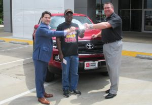 Rob Tharp, GM of Honda of Denton, Don Moody and Scott Fly, GM of Toyota of Denton.