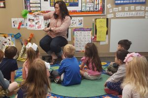 First-time author Jill Lange of Flower Mound reads her book to students at Lamb of God Preschool.