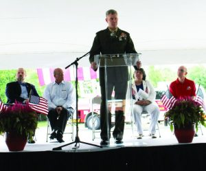 Colonel Paul T. Patrick delivers a keynote address. Sitting behind him are (left to right) Mayor Pro Tem Kevin Bryant, Flower Mound Council Member Bryan Webb, Ret. Lt. Colonel Ginger Simonson, and Flower Mound Fire Department Chaplain Russ McNamer. Photo by Dru Murray.