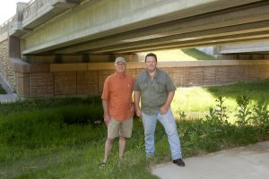 James Lee and Mark Glover with the Cross Timbers Bat Initiative scout out a possible home for bats on South Garden Ridge Boulevard in Flower Mound. (Photo by Helen's Photography)