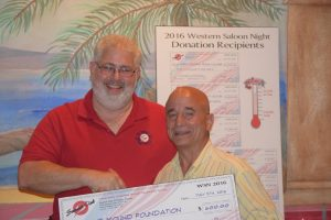 Al Picardi of The Mound Foundation accepts a $600 donation from Summit Club of Flower Mound president Claudio Forest.