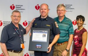 Pictured (from left): Dr. Ray Fowler, Co-Chair Mission: Lifeline North Texas; Argyle Fire Lieutenant Cody Miller; former Chief Jerry Kirby; Takiyah Wilson, Mission: Lifeline Director North Texas. (Photo courtesy of American Heart Association)