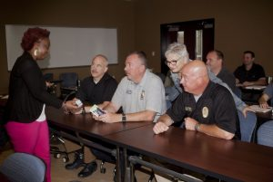 Tanesha Tyler-Carr (left) with the Dallas Chapter of the Alzheimer's Association trains members of the Highland Village Police Department how to recognize the signs of dementia and deal with the needs of people with the disease. (Photo by Helen's Photography)