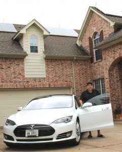 Jay Squyres and his family's purchase of solar panels led to a growing awareness of climate change and prompted them to invest in an eco-friendly Tesla. (Photo by Dru Murray)