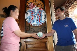 Budding entrepreneur Nick Crabill sells his homemade ice cream to fellow Lantana resident Cathy Moilan.