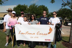 Lantana Cares volunteers Mark Lott, Jessica Lott, Anna Horvath, Brenda Horvath, Christian Keller, Bill Featherstone and Christy Wong clean up the Lantana Green.
