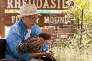 Oleta Faye Turner, better known as Aunt Faye, enjoys the company of chickens on her nephew's farm in Flower Mound. (Photo by Helen's Photography)