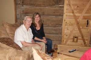 Wallace Lynch and daughter, Karyl Smith-log cabin WEB