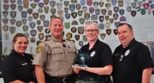 Denton County Sheriff's deputies Leslie Willingham, Charley Smith, Penny Campbell and Bob Hargenrater, of the Community Policing Unit were recognized by the Texas Crime Prevention Association for their outreach efforts.